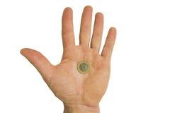 Moneta w mężczyzna ręce Obraz Stock