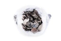 moneta w plastikowym worku odizolowywającym na bielu Obrazy Royalty Free