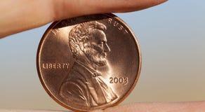 Moneta w ręce Zdjęcia Stock