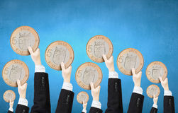Monetary concept. Crowd of people holding five euro coin stock images