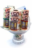 Monetary denominations laid in a vase Royalty Free Stock Image