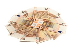 Monetary denominations lie on a circle. On a white background Royalty Free Stock Photos
