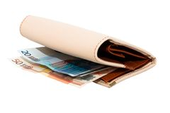 Monetary denominations lie in a wallet on a white Royalty Free Stock Photography