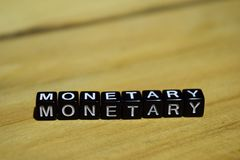 Monetary written on wooden blocks. Inspiration and motivation concepts. Cross processed image on Wooden Background stock photos