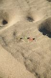 Monete alla spiaggia Fotografie Stock