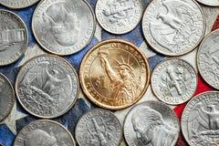 Monete americane del centesimo e del dollaro Immagini Stock