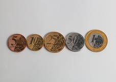 Monete brasiliane correnti reali nell'ordine crecent Fotografie Stock Libere da Diritti