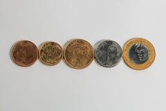 Monete brasiliane del fronte corrente reali nell'ordine crescente Immagini Stock Libere da Diritti