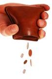 Monete che cadono dal raccoglitore Fotografie Stock