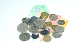 Monete con le banconote della Malesia Foto di concetto Fotografie Stock