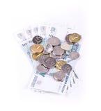 Monete del giacimento detritico sulle banconote Fotografia Stock