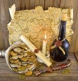 Monete del pirata con la candela Fotografia Stock Libera da Diritti
