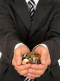 Monete della holding Immagine Stock