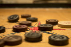 Monete di Carrom fotografia stock