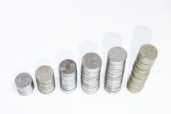 Monete di crescita di soldi Immagini Stock