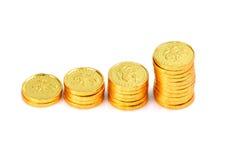 Monete di oro fotografie stock