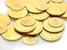 Monete di oro impresse con le immagini Fotografia Stock Libera da Diritti