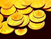 Monete di oro impresse con le immagini Immagini Stock