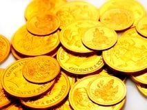 Monete di oro impresse con le immagini Fotografie Stock Libere da Diritti