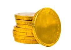 Monete di oro isolate Fotografie Stock