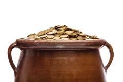 Monete di oro nel vaso d'annata Immagini Stock Libere da Diritti