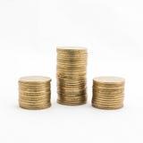 Monete di oro su priorità bassa bianca Immagine Stock Libera da Diritti