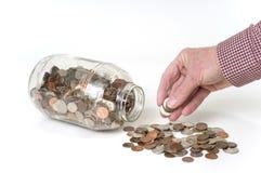 Monete di risparmio Immagine Stock