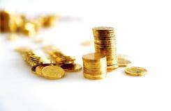 Monete dorate luminose Fotografia Stock