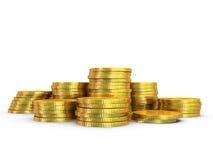 Monete dorate su fondo bianco Fotografia Stock