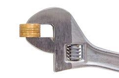 Monete e chiave dorate della colonna Fotografia Stock Libera da Diritti