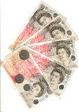 Monete e cinquanta libbre Immagine Stock Libera da Diritti
