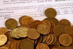 Monete e conto Fotografia Stock Libera da Diritti