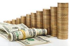 Monete e dollaro Fotografie Stock