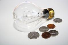 Monete e lampadina Fotografia Stock Libera da Diritti