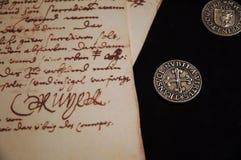 Monete e lettera antiche Fotografie Stock