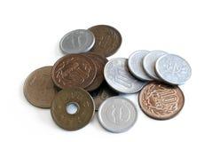 Monete giapponesi sparse Immagini Stock