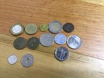 Monete intorno al mondo Immagini Stock