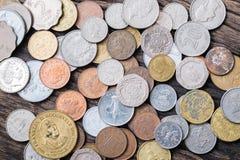 Monete miste internazionali Fotografie Stock