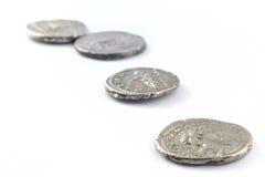 Monete romane isolate immagine stock