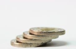 Monete su bianco immagine stock libera da diritti
