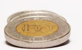 Monete su bianco immagine stock