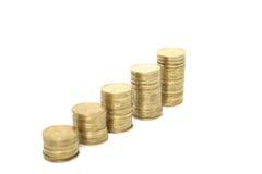 Monete su priorità bassa bianca Immagini Stock Libere da Diritti