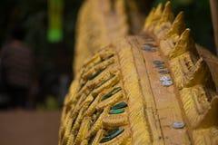 Monete sulla parte della statua dei Nagas Immagine Stock Libera da Diritti