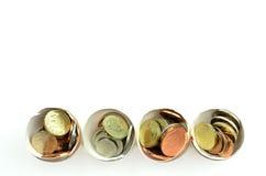Monete in uova Fotografie Stock Libere da Diritti