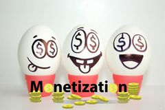 Monetization concept. funny. And funny eggs with a face. satire Stock Images