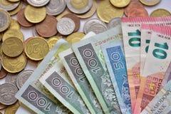 Monety, banknoty i Zdjęcie Stock