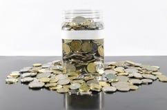 monety folujący słój Zdjęcia Royalty Free