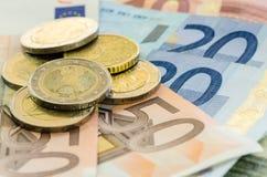 Monety i banknoty obrazy stock