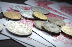 Monety i karta do gry Zdjęcia Stock