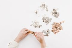 monety interliniują biel Zdjęcia Royalty Free
